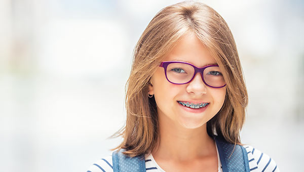 Young Girl Slider PWP Orthodontics in Clinton and Goldsboro, NC